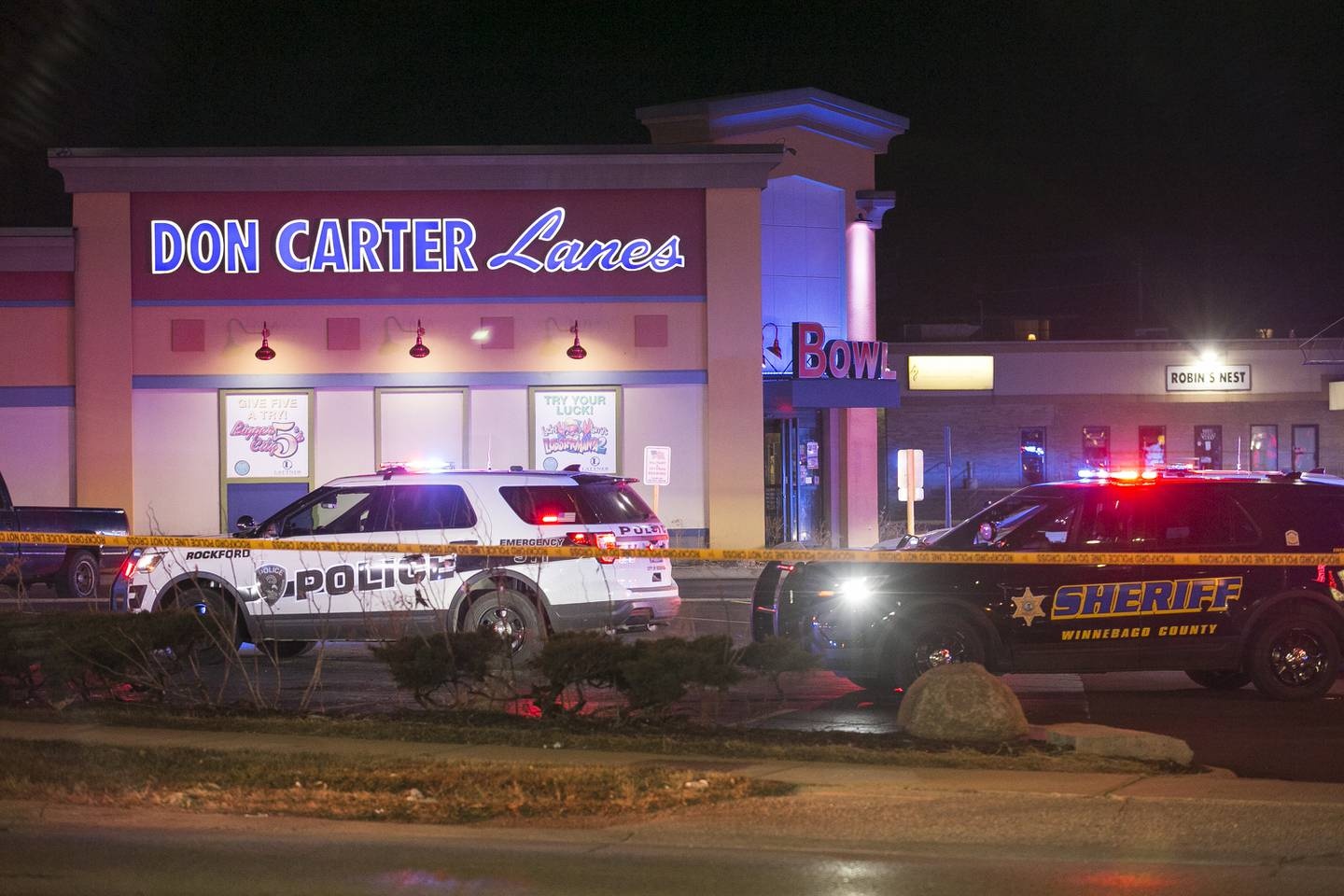 Rockford police and other law enforcement agencies investigate the scene of a shooting at a bowling alley Saturday, Dec. 26, 2020, in Rockford, Ill.
