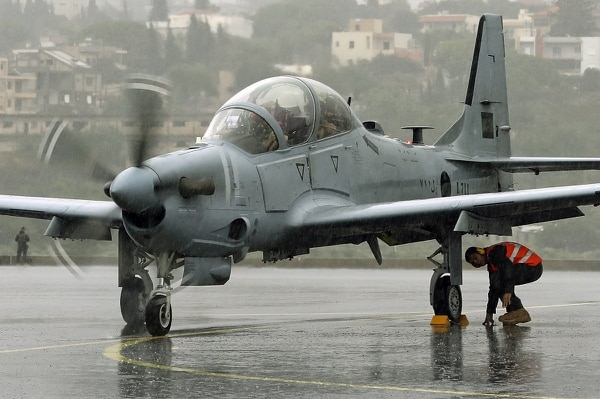One of two Brazilian-built A-29 Super Tucano planes that were handed over by the U.S. government to the Lebanese Army arrives at the Lebanese air base of Hamat, north of Beirut, on Oct. 31, 2017. (Joseph Eid/AFP via Getty Images)
