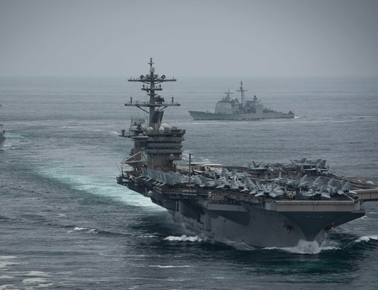 The aircraft carrier Theodore Roosevelt, destroyer Russell and cruiser Bunker Hill conducting routine operations in the Eastern Pacific Ocean. (MC2 Anthony Rivera/Navy)