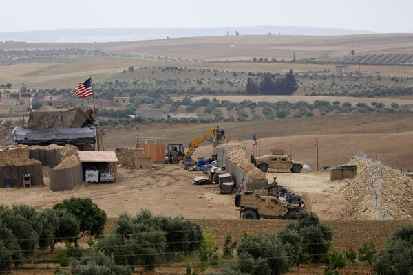 A picture taken on May 8, 2018, shows vehicles and structures of the US-backed coalition forces in the northern Syrian town of Manbij. The U.S. and Turkey have reached a deal June 4, 2018, where U.S.-backed Kurdish fighters will withdraw from Manbij. (Delil souleiman/AFP via Getty Images)