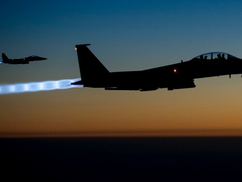 Two U.S. Air Force F-15E Strike Eagle aircraft fly over northern Iraq. The U.S.-led coalition has ramped up its airstrikes against the Islamic State in recent weeks. (Senior Airman Matthew Bruch/Air Force)