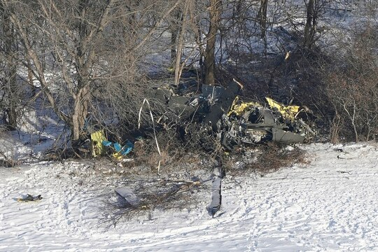 This aerial photo shows the crash site of a Minnesota National Guard Black Hawk helicopter Dec. 6, 2019, near Kimball, Minn. Three soldiers were killed in the crash at the edge of a farm field about 30 miles south of St. Cloud. (Brian Peterson/Star Tribune via AP)