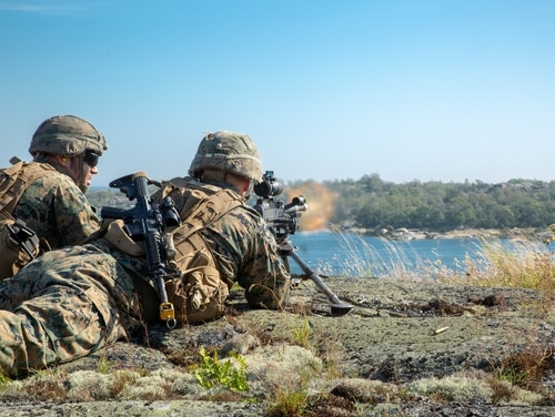 U.S. Marines with 1st Battalion, 8th Marines, Marine Rotational Force–Europe 19.2, Marine Forces Europe and Africa, provide suppressive fire during an archipelago raid as part of Exercise Archipelago Endeavor 19 in the Archipelago Islands, Sweden, Aug. 28, 2019. (Lance Cpl. Joseph Atiyeh/Marine Corps)