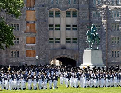 Members of the senior class march past a statue of George Washington during Parade Day at West Point in May 2019. (Mark Lennihan/AP)