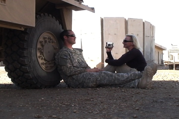 Alex Quade interviews a Special Forces soldier between missions in Iraq in 2008.