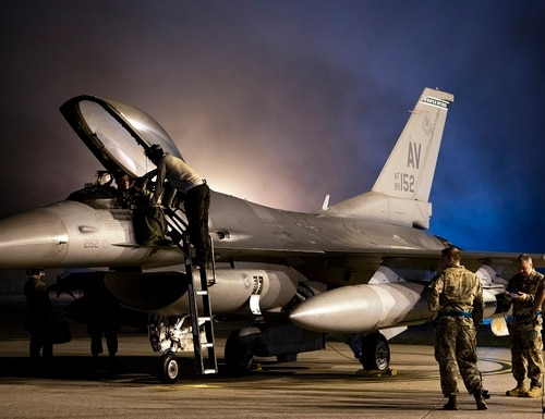 Airmen prepare a 555th Fighter Squadron F-16 Fighting Falcon for takeoff from Aviano Air Base, Italy, Oct. 28, 2019. The Triple Nickel deployed in support of U.S. Air Forces Central Command. (Airman 1st Class Caleb House/U.S. Air Force)