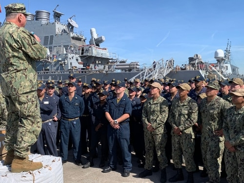 Chief of Naval Personnel Vice Adm. John Nowell talks to sailors assigned to the guided-missile destroyers Ross and Gridley during an Oct. 7 all hands call on the waterfront at Naval Station Rota in Spain. (Navy)