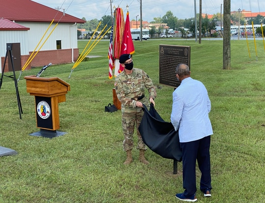 Rep. Sanford Bishop, D-Ga., and Lt. Gen. Theodore Martin unveil a memorial plaque honoring Pvt. Felix Hall on Fort Benning, Georgia, August 3, 2021. The marker is located where Hall, who was lynched, was last seen alive. (Staff/Davis Winkie)