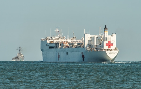 Norfolk, Va. (Sept. 30, 2017) The Hospital Ship Comfort follows the destroyer McFaul through the Chesapeake Bay on the way to the Atlantic Ocean. Comfort is on the way to Puerto Rico to provide relief to the U.S. Territory. She is expected to arrive in five days. (Mark D. Faram/staff)
