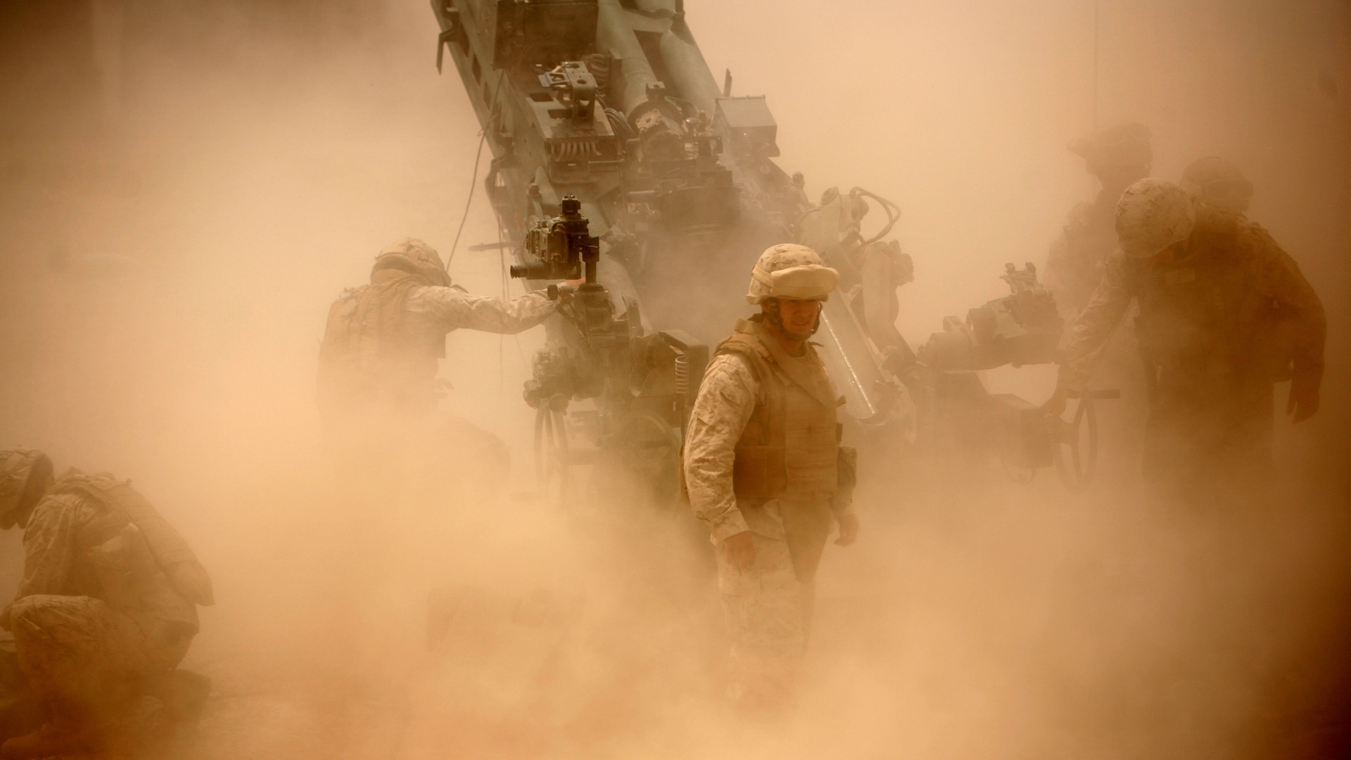 Marines from Battery M, 3rd Battalion, 11th Marine Regiment fire an M777 howitzer during a training exercise aboard Camp Fallujah, Iraq, April 19, 2008. (Sgt Nathaniel C. LeBlanc/Marine Corps)