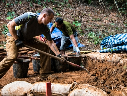U.S. Army Cpt. Colin O'toole, team leader with the Defense POW/MIA Accountability Agency (DPAA) digs during an effort to locate missing service members from the Vietnam War in Ratanakiri, Cambodia, April 3, 2017. (Sgt. Demetrius Munnerlyn/Marine Corps)