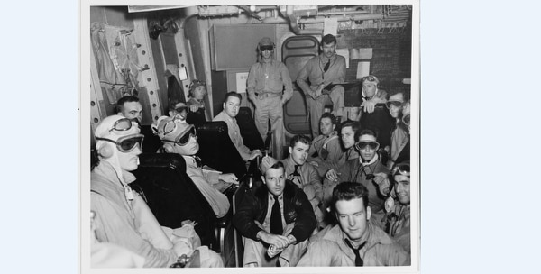 Fighter pilots gather in a ready room on board the aircraft carrier Ranger (CV-4) before dawn of the first day of attacks on North Africa, Nov. 8, 1942. Pilots scheduled to take off before dawn wear dark goggles to accustom their eyes to darkness. (National Archives)