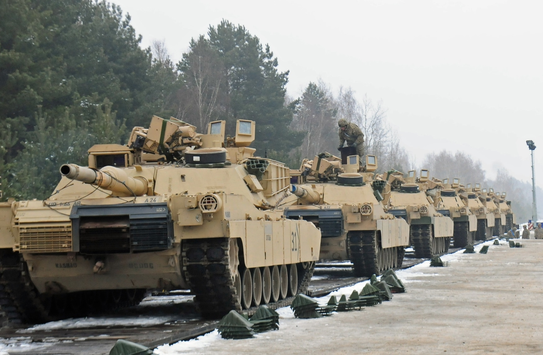 M1A2 Abrams tanks belonging to 1st Battalion, 66th Armored Regiment, 3rd Armored Brigade Combat Team, 4th Infantry Division are loaded onto a flatcar railway Jan. 25, 2017, as part of Atlantic Resolve. (Staff Sgt. Corinna Baltos/Army)