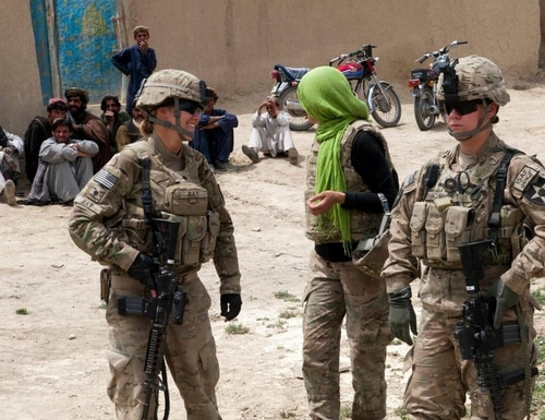 Spc. Heather Ray, left, Pfc. Jacqueline Buschman and their female interpreter, return from a meeting with some Afghan women in the village of Akhvond Qalay, Afghanistan, May 8, 2012. (Sgt. Christopher McCullough/Army)