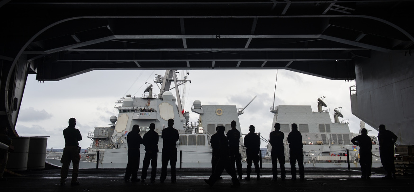 Sailors aboard the U.S. Navy aircraft carrier Theodore Roosevelt in the South Chia Sea watch the destroyer John Finn approach for a replenishment at sea. (MC1 Chris Cavagnaro/U.S. Navy)