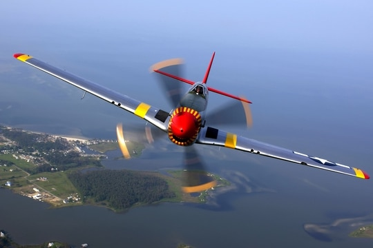 A P-51 Mustang in flight during a 2017 air show at Langley Air Force Base, in Virginia. A private company in Hawaii will soon start taking sightseers up in their vintage Mustang, which was known as one of the best fighter planes to fly over Europe during the latter part of World War II. (File)