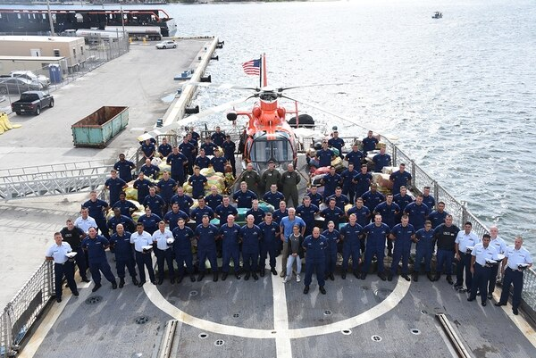 Coast Guard Cutter Bear (WMEC-901) crewmembers stand among interdicted drugs on the flight deck of the cutter April 18, 2019, at Port Everglades, Fla. (Petty Officer 3rd Class Brandon Murray/Coast Guard)
