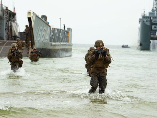 U.S. Marines march to the beach from a landing craft utility boat as part of an amphibious assault for exercise Baltic Operations 2019. (MC3 Jack D. Aistrup/U.S. Navy)