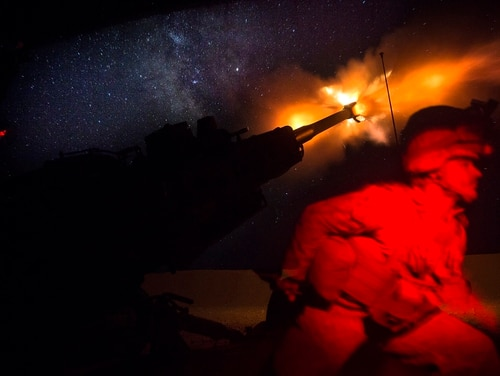 A U.S. Marine fires an M777-A2 Howitzer in the early morning in Syria, June 3. (U.S. Marine Corps photo by Sgt. Matthew Callahan)