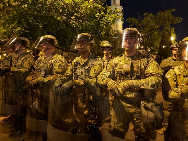 Soldiers with patches from South Carolina National Guard's 218th Maneuver Enhancement Brigade stand in line near the White House on June 3, 2020. (Kyle Rempfer/Staff)