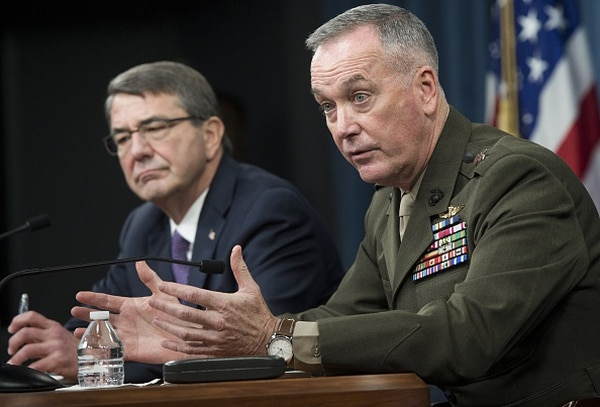US Secretary of Defense Ashton Carter(L) and Chairman of the Joint Chiefs of Staff Joseph Dunford hold a press briefing at the Pentagon in Washington, DC, March 25, 2016. The Islamic State group's second in command has been killed in a US raid in Syria, Pentagon chief Ashton Carter confirmed March 25, 2016, in a move he said would hamper the operational ability of the jihadists.
