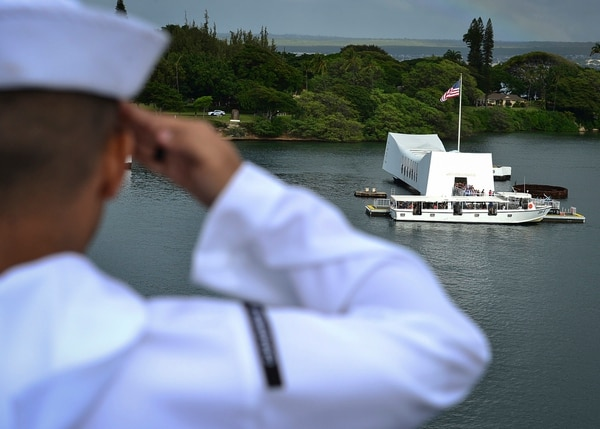 U.S. Navy sailors render honors aboard the aircraft carrier USS Nimitz (CVN 68) on Nov. 21, 2017, as the ship passes the USS Arizona Memorial at Joint Base Pearl Harbor-Hickam. (MC3 Cole Schroeder/Navy)