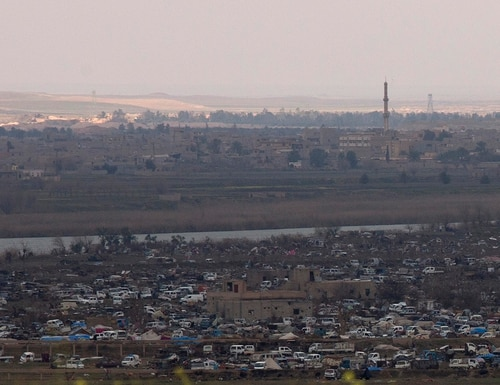 The Islamic State group's last pocket of territory in Baghouz, Syria, as seen from a distance on Sunday, March 17, 2019. (Maya Alleruzzo/AP)