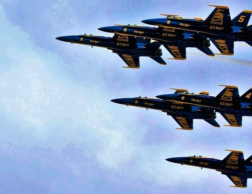 The U.S. Navy Blue Angels demonstrate the capabilities of the F/A-18 Hornet at the 2019 Marine Corps Air Station Miramar Air Show in California Sept. 28. This year's air show has been cancelled due to the ongoing COVID-19 pandemic. (Pfc. Victor Mackson/Marine Corps)