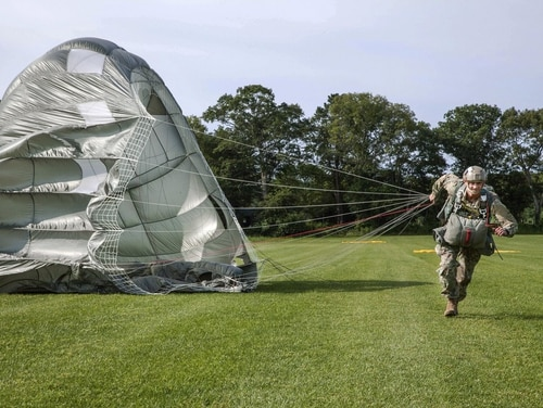 An Army paratrooper makes contact with the drop zone during Leapfest 2017 at the University of Rhode Island in West Kingston, R.I., Aug. 6, 2017. Leapfest is the oldest and largest international static line parachute training event and competition. (Sgt. Joshua Wooten/Army)