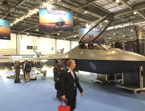 Visitors walk past a mock-up of the Tempest combat aircraft at the 2019 DSEI defense trade show in London on Sept. 11, 2019. (Sebastian Sprenger/Staff)