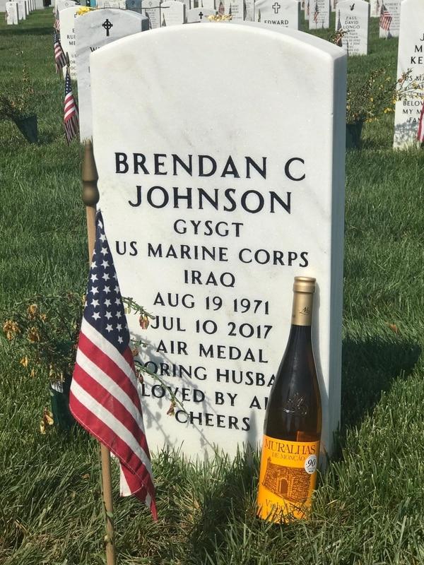 Gunnery Sgt. Brendan Johnson's headstone, adorned with the bottle of wine. (Jon Lubecky)