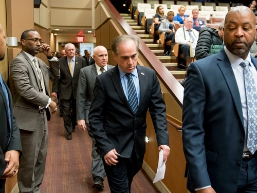 Veterans Affairs Secretary David Shulkin, center, arrives for a news conference at the Washington D.C. Veterans Affairs Medical Center on March 7, 2018. On Wednesday, following a month of controversies, Shulkin was fired by President Donald Trump. (Andrew Harnik/AP)