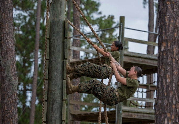 Rct. Ryleigh L. Stayrook, front, and Rct. Mariah A. Sanchez, both with Platoon 4003, November Company, 4th Recruit Training Battalion, climb a Confidence Course obstacle Nov. 18, 2015. The course is comprised of 15 obstacles designed to help Marine Corps recruits build confidence by overcoming physical challenges. Stayrook, 20, from Dayton, Ohio, and Sanchez, 18, from Chandler, Ariz., are scheduled to graduate Jan. 22, 2016. Parris Island has been the site of Marine Corps recruit training since Nov. 1, 1915. Today, approximately 19,000 recruits come to Parris Island annually for the chance to become United States Marines by enduring 13 weeks of rigorous, transformative training. Parris Island is home to entry-level enlisted training for approximately 50 percent of males and 100 percent of females in the Marine Corps. (Photo by Sgt. Jennifer Schubert)