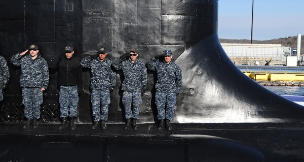 Sailors of Pre-Commissioning Unit Colorado (SSN 788) salute in front of the sail during a rehearsal in preparation for Colorado's commissioning on March 17, 2018. Colorado is the the U.S. Navy's 15th Virginia-class attack submarine and named for the State of Colorado. (Chief Petty Officer Darryl I. Wood/Navy)
