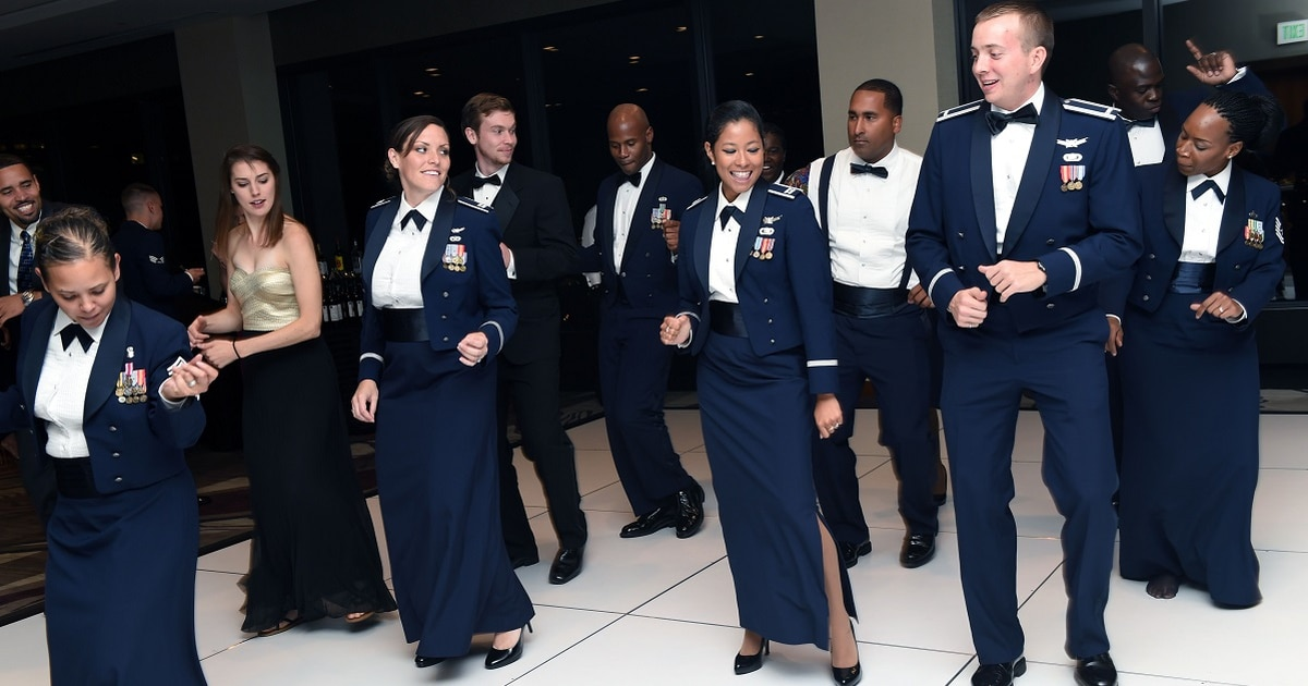 Say goodbye to the floor-length skirt: Air Force now allows women to wear pants with mess dress