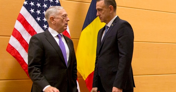 In this Wednesday, Nov. 8, 2017 file photo, U.S. Secretary for Defense Jim Mattis, left, speaks with Romanian Defense Minister Mihai-Viorel Fifor prior to a meeting on the sidelines of a NATO defense ministers meeting at NATO headquarters in Brussels. (Virginia Mayo, Pool/AP)