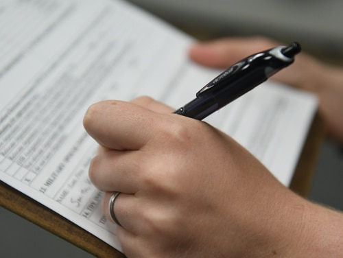 A spouse at Dyess Air Force Base, Texas, applies for reimbursement of costs for professional relicensing after a PCS move. (Senior Airman Susan Roberts/Air Force)