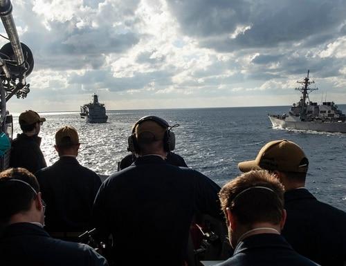 The cruiser Vella Gulf and the destroyer Laboon come alongside the fleet-replenishment oiler USNS Kanawha in the Atlantic Ocean Jan. 15. (MC2 Dean Cates/Navy)