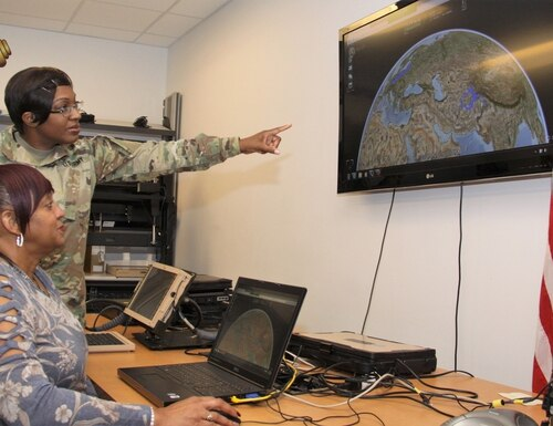 Capt. Tawanda Baxter and Flora Marshall, of Army Project Manager Mission Command, demonstrate the Tactical Interface Tracking Application Node at Aberdeen Proving Ground, Md. (Dan Lafontaine/Army)