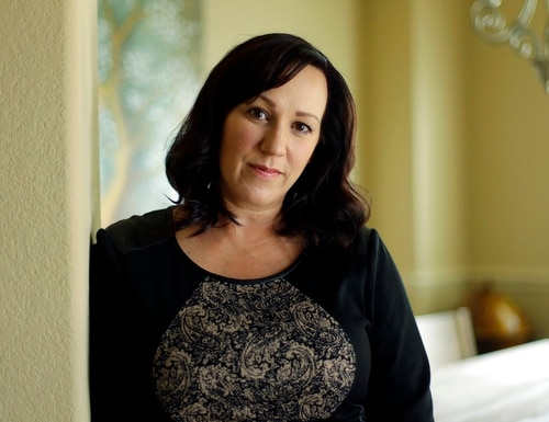 MJ Hegar poses for a portrait at her home in Round Rock, Texas, on Thursday, Aug. 9, 2018. Nine years after being shot down in Afghanistan, winning a lawsuit against the federal government, and writing a book, Hegar is now running for a Texas congressional seat. Women with military experience — many of them combat veterans — are among the record number of female candidates running for office this year. (Eric Gay/AP)