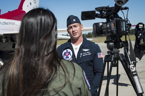 Lt. Col. Kevin Walsh has been named commander of the Thunderbird. Here, he speaks to a local reporter at Moody Air Force Base, Ga. (Senior Airman Janiqua P. Robinson/Air Force)
