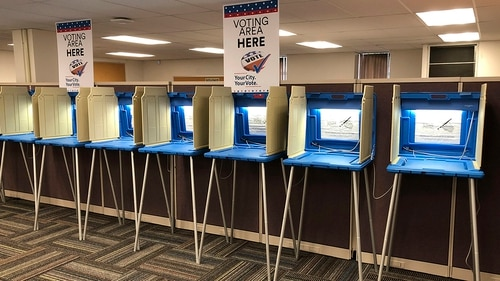 In this Sept. 20, 2018 photo, voting booths stand ready in downtown Minneapolis for the opening of early voting in Minnesota. Election officials and federal cybersecurity agents are touting improved collaboration aimed at confronting and deterring efforts to tamper with elections. (Steve Karnowski/AP)