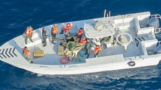 In this handout photo provided by the U.S. Department of Defense, imagery taken from a U.S. Navy MH-60R helicopter shows the Islamic Revolutionary Guard Corps Navy after removing an unexploded limpet mine from the M/T Kokuka Courageous. The Motor Tanker (M/T) Kokuka Courageous sustained damage from a limpet mine attack while operating in the Gulf of Oman, on June 13th. Limpet mines are attached to a vessel via magnets and/or nails and detonated by a timer. Following the attack, sailors from the Kokuka Couragous discovered a second, unexploded, limpet mine on their vessel and abandoned ship. (Photo by U.S. Department of Defense via Getty Images)