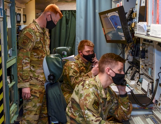 2nd Lt. William Young, 741st Missile Squadron missile combat crew commander, 1st Lt. Darian Titus, 741st Missile Squadron deputy missile combat crew commander and Capt. James Kelley, 576th Flight Test Squadron ICBM test operator, participate in a Simulated Electronic Launch Minuteman exercise on April 7, 2021, at Minot Air Force Base, N.D. (Senior Airman Josh W. Strickland/Air Force)