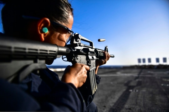 171108-N-BK384-462 MEDITERRANEAN SEA (Nov. 8, 2017) Seaman Joanna Valdez, assigned to the deck department aboard the San Antonio-class amphibious transport dock ship USS San Diego (LPD 22), fires an M4A1 Carbine during a live-fire training exercise on the ship's flight deck. San Diego is deployed with the America Amphibious Ready Group and the 15th Marine Expeditionary Unit to support maritime security and theater security cooperation in efforts in the U.S. 6th Fleet area of operations. (U.S. Navy photo by Mass Communication Specialist 3rd Class Justin A. Schoenberger/Released)