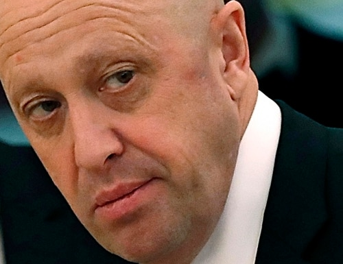 In this July 4, 2017, photo, Russian businessman Yevgeny Prigozhin is shown prior to a meeting of Russian President Vladimir Putin and Chinese President Xi Jinping in the Kremlin in Moscow, Russia. The Justice Department is moving to drop charges against some Russian companies that were accused of funding a social media campaign to sway American public opinion during the 2016 U.S. presidential election. (Sergei Ilnitsky/Pool Photo via AP)
