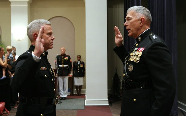 Gen James. T. Conway, 34th Commandant of the Marine Corps, promotes Lt. Gen. James F. Amos, commander of Marine Corps Combat Development Command, to the rank of general at Marine Barracks Washington July 2. Amos is slated to become the 31st Assistant Commandant of the Marine Corps. Official Marine Corps photo by Lance Cpl. Jacob H. Harrer