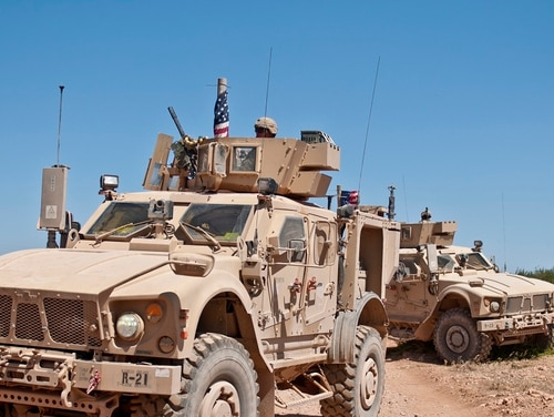 U.S. military vehicles provide security during their independent, coordinated patrol outside Manbij, Syria, July 16, 2018. (Staff Sgt. Timothy R. Koster/Army)