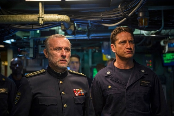 This image released by Lionsgate shows Michael Nyqvist, left, and Gerard Butler in a scene from