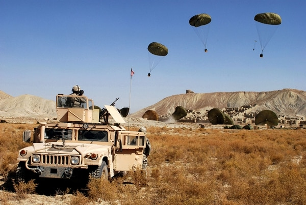 Paratroopers from the 82nd Airborne Division watch as C-17 Globemaster IIIs airdrop cargo bundles carrying food and water in Paktika Province, Afghanistan, earlier in the war there. (Spc. Micah E. Clare/Army)